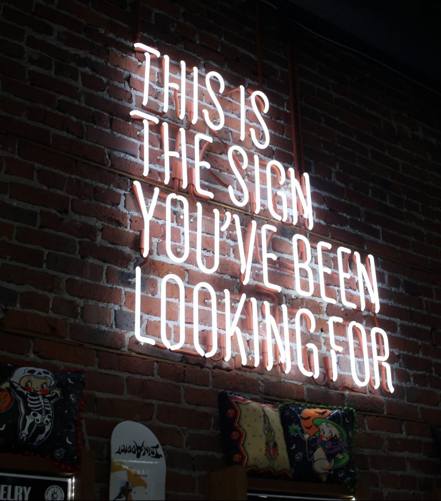 Neon sign that says 'This is the sign you have been looking for'